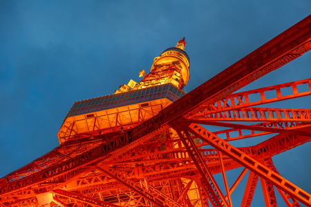 Spectacular bottom view of Tokyo Tower illuminated at night. The Tokyo Tower is a telecommunications building and also a panoramic observatory located in Minato district, Tokyo, Japan. Stock Photo