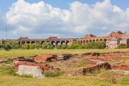 Interior wall, harbor light and parade ground in the large inner courtyard of Fort Jefferson, a historical military fortress, in Dry Tortugas National Park, Florida.