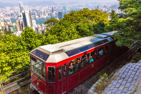 Hong Kong, China - December 10, 2016: The red Peak Tram to Victoria Peak, the highest peak of Hong Kong island. The Tram full of tourists, is the most popular attraction in the city.