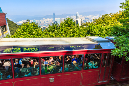 Hong Kong, China - December 10, 2016: The red Peak Tram to Victoria Peak, the highest peak of Hong Kong island. Close up of tram full of tourists, the most popular attraction in the city. Editorial