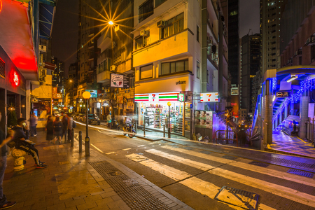 Hong Kong, China - December 10, 2016: Eleven mini market in Elgin Street by night, popular road Soho district in Central Hong Kong, famous for bars, restaurants, clubs and nightlife. Editorial