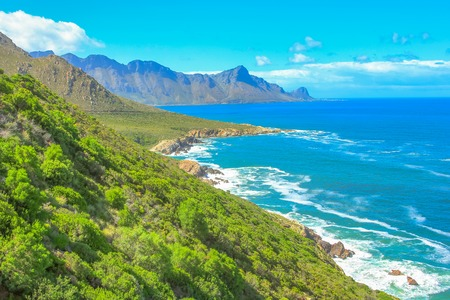 Scenic coastal R44 on eastern part of False Bay near Kogel Bay Beach between Gordons Bay and Pringle Bay in Western Cape, South Africa. Beautiful mountain scenery along Route 44 in summer season.