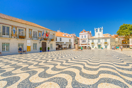 Cascais, Portugal - August 6, 2017: side view of Cascais Town Hall with azulejos and King Peter I Statues, Outubro Square, historic Cascais center, the most popular holiday destination on Lisbon coast Editorial