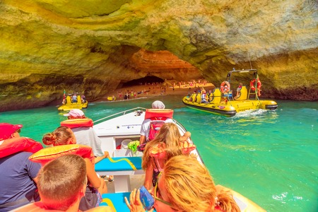 Benagil, Portugal - August 23, 2017: Benagil Cave Boat Tour inside Algar de Benagil the famous sea cave in Algarve coast, Lagoa, Portugal. Bevagil Cave seen by the boat trip with many people. Editorial