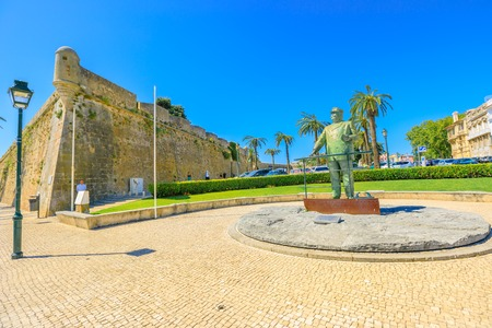 Cascais, Portugal - August 6, 2017: Statues in honor of King Carlos I near Fortress of Our Lady of Light along the harbor promenade in Cascais the most popular holiday destination on Lisbon coast.