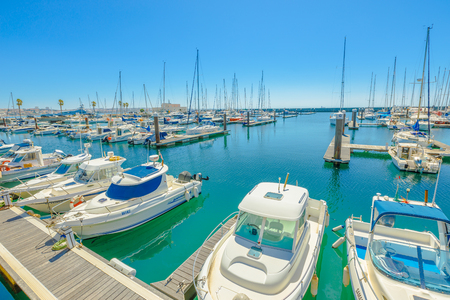 Cascais, Portugal - August 6, 2017: yacht and motor boats docked at Cascais marina. The Marina is located under Cascais Cidadela. Summer holidays in sunny day. Turquoise bay. Blue sky with copy space. Editorial