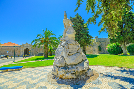 Cascais, Portugal - August 6, 2017: Monument Infantry Regiment or statue of Peninsular war against Cascais fortress Our Lady of Light in Cascais the most popular holiday destination on Lisbon coast.