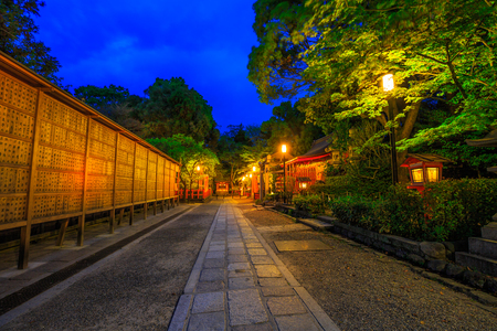 Kyoto, Japan - April 25, 2017: Illuminated path at dusk from Yasaka Shrine to the Gion weeping cherry tree in Maruyama Park. Gion Shrine is one of the most famous shrines in Kyoto, Japan .