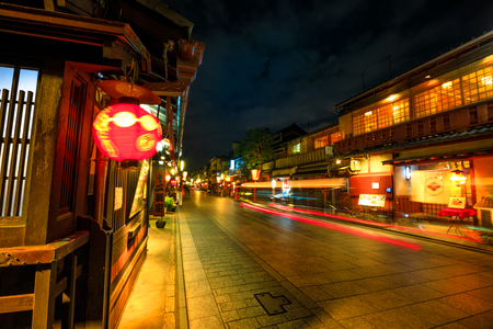 Kyoto, Japan - April 24, 2017: light trail by night at Gion Kobu district with typical Kaiseki restaurant. Gion is Kyotos most famous geisha district, Hanamachi, located in Kyoto, Japan.