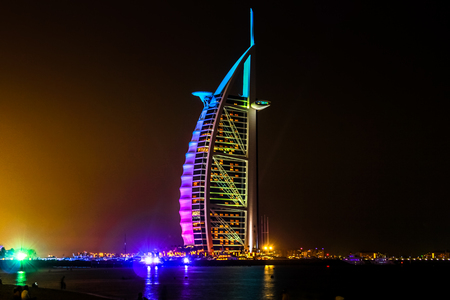 Dubai, UAE - May 3, 2013: Burj Al Arab, 7 stars hotel built on an artificial island near Jumeirah beach. Tower of the Arabs or Arab Sail is the tallest hotel in the world and the most luxurious Dubai.