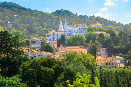 Panoramic aerial view of National Palace of Sintra or Town Palace, in Portuguese Palacio Nacional de Sintra, with two white famous chimneys rising out of palace. Sintra, Portugal. Unesco Heritage Site