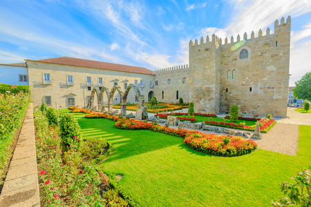 Braga, Portugal. A side of architectural complex of medieval Episcopal Palace of Braga or Paco Episcopal Bracarense in town hall square or Praca do Municipio. Sunny day. Editorial