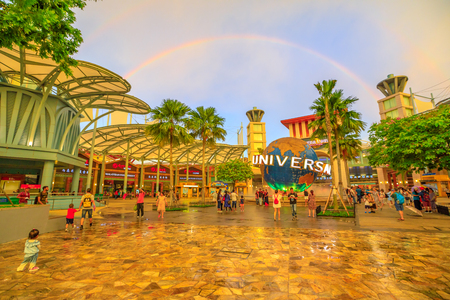 Singapore - May 2, 2018: Sentosa Bull Ring square with Universal Studios world globe in a rainbow at sunset. Famous place for holidays.Universal Studios is the first Hollywood movie theme park in Asia Redakční