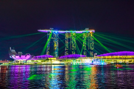 Singapore - April 27, 2018: great laser show at night time at Marina Bay Sands Hotel and Casino and ArtScience Museum. Laser lights on the waters of Marina Bay Waterfront promenade in Singapore.