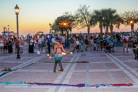 Key West, Florida, United States - April 12, 2012: fire eater walking on hot coals during the Sunset Celebration, Mallory Square. Show of street artists is one of most popular attractions of Key West. Sajtókép