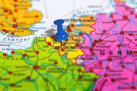 Brussels in Belgium pinned on colorful political map of Europe. Geopolitical school atlas. Tilt shift effect. Stock Photo