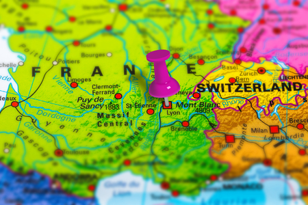 lyon in France pinned on colorful political map of Europe. Geopolitical school atlas. Tilt shift effect.