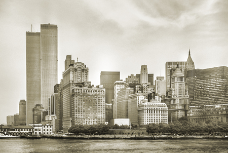 New York City skyline from NJ with World Trade Center featured as landmark of Twin Towers, destroyed in September 11, 2001. Sepia background, vintage style. Lower Manhattan in NYC, United States. 스톡 콘텐츠