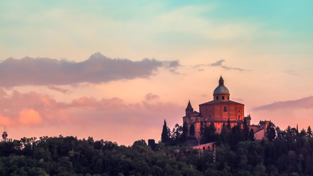 San Luca basilica church on Bologna hill, in a colorful twilight. orange and blue. in Italy 스톡 콘텐츠