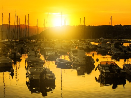Gulf of Poets with docket boats in Lerici medieval town at sunset light from Lerici harbor, La Spezia province, Ligurian Coast, Italy. Famous travel destination for summer holidays. 写真素材