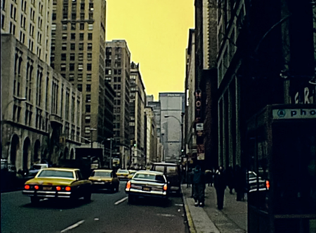 New York, United States America - 1981: typical old buildings with fire escapes on the facade in Manhattan with old HQ of Pan Am building, actual MetLife Building, from E 44th St. Archival USA on 80s. 報道画像
