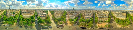 Paris 360 degrees skyline panorama from top of Arc de Triomphe on Champs Elysees street.Tour Eiffel tower, Basilica of the Sacred Heart and Tour Montparnasse tower landmarks in Paris, France, Europe.