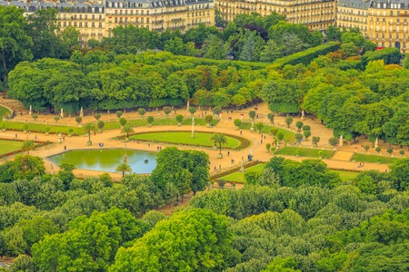 Closeup of Le Jardin du Luxembourg gardens from panoramic terrace of Tour Montparnasse. Aerial view of Paris urban public park, and french style gardens of residence palace of the Senate President.