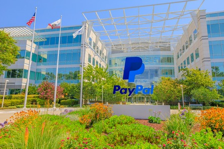 San Jose, CA, United States - August 12, 2018: flags of Paypal Headquarters in Silicon Valley. Paypal is a multinational corporation that provides a virtual bank service and payments through internet Editorial