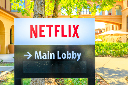 Los Gatos, California, United States - August 12, 2018: Netflix Logo at spanish-style buildings of Netflix, headquarters of streaming giant in Silicon Valley. Netflix Building A and B: main lobby. Editorial