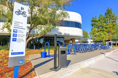 Mountain View, California, United States - August 13, 2018: Linkedin Campus Bike Parking with employes bikes lined up in Silicon Valley. Linkedin Corp HQ connects the worlds professionals. Editorial