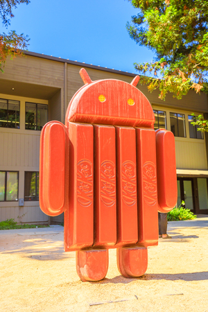 Mountain View, CA, United States - August 13, 2018: Android kitkat statue at Googles Merchandise Store and Google Visitor Center Beta. Android lawn are a popular place for selfies. Vertical shot