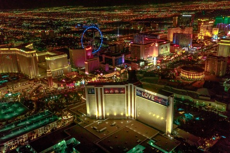 Las Vegas, Nevada, United States - August 18, 2018: aerial view of Las Vegas Strip by night. Scenic flight: High Roller Ferris Whell, The Mirage, Flamingo, Caesars Palace, The Paris, Casino Bellagio.