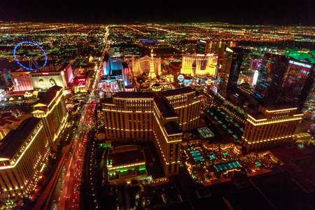 Las Vegas, Nevada, United States - August 18, 2018: aerial view of Las Vegas Strip Skyline illuminated by night. Scenic flight above: High Roller, Cosmopolitan, The Paris, bellagio Casino and Hotel.