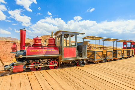 Calico, California, USA - August 15, 2018: Calico Station and Odessa Railroad narrow gauge that with an old steam train does a tour through old mines of Calico Ghost Town, San Bernardino County. 報道画像