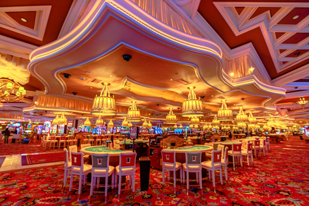 Las Vegas, Nevada, United States - August 18, 2018: rows of blackjack tables and slot machine inside the luxurious Wynn Las Vegas Resort Hotel, a 5-star, themed Paradise Las Vegas Strip, Nevada.
