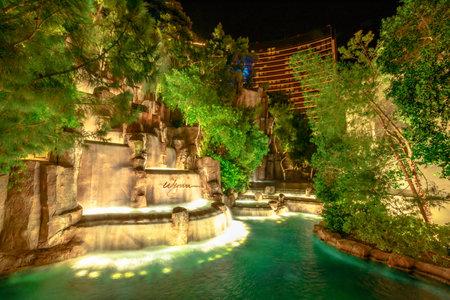 Las Vegas, Nevada, United States - August 18, 2018: Wynn Las Vegas Waterfall Fountain. The Wynn is Resort Hotel 5-star casino in Las Vegas Strip. Falls in the garden outdoors illuminated by night. 報道画像