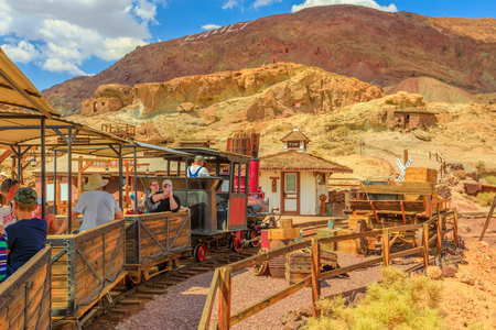 Calico, California, United States - August 15, 2018: Calico train runs a tourist trip through old mines of Calico Ghost Town on Calico Mountains. Editorial