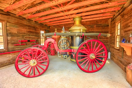 Calico, CA, USA - August 15, 2018: fire engine inside Fire Hall. Main street in Cowboy Theme Park, Yermo. Calico was designated Silver State Rush Ghost Town of California, San Bernardino County. Editorial