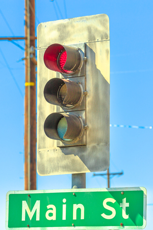 Closeup of red light along Main Street or Route 66 in Barstow, California in San Bernardino County, Mojave Desert, United States of America. Stock Photo