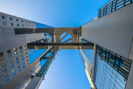 Osaka, Japan - April 28, 2017: bottom view of Floating Garden Observatory in Umeda Sky Building, Kita-ku district.The structure consists of two twin towers connected to each other in the higher floors