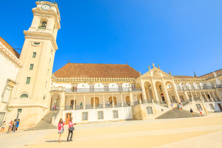 Coimbra, Portugal - August 14, 2017: people at iconic University Clock Tower in Paco das Escolas. The University of Coimbra is the most ancient of Portugal and also one of the oldest in Europe.
