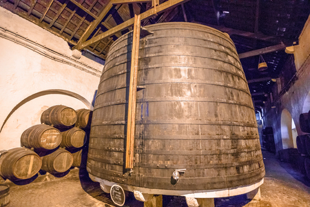 Porto, Portugal - August 13, 2017: cellar with traditional big wooden wine barrels. Ferreira Winery in Vila Nova de Gaia, one of the most popular wine tasting tours.Vila Nova is famous for its cellars