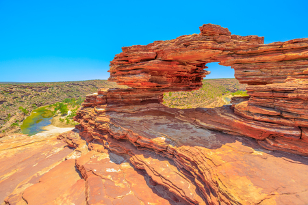 Natures Window over Murchison River Gorge in Kalbarri National Park, Western Australia. The red rock sandstone arch is the most iconic natural attractions in WA.