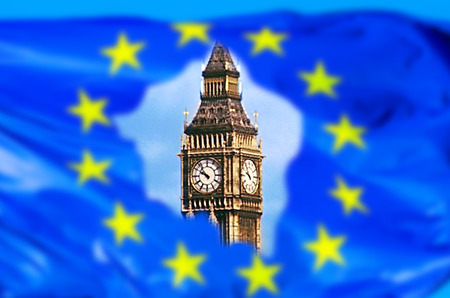 European flag broken by United Kingdom exit with Big Ben tower of London, the house of a British parliament. The financial concept for Brexit and EU division.