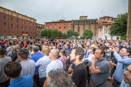 Bologna, Italy - May 10, 2014: vast crowd listening famous politician Beppe Grillo speaking in Piazza San Francesco for Movimento 5 Stelle M5S party. Multitude of people together for a political event