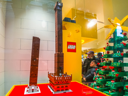 Bologna, Italy - December 6, 2018: construction model in Lego blocks of the Famous the Due Torri towers of Bologna. In Lego store of Via Indipendenza street.