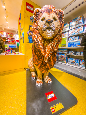 Bologna, Italy - December 6, 2018: the King Lion statue made of Lego bricks in Bologna. Located in Via Indipendenza street, inaugurated on 6th December 2018 at new Lego Store.