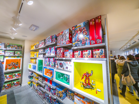 Bologna, Italy - December 6, 2018: people shopping at famous Lego toys store of Bologna. Store full of people for the recent inauguration.