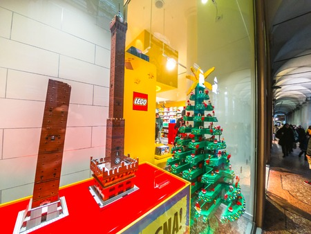 Bologna, Italy - December 6, 2018: Due Torri of Bologna construction model in Lego blocks of the Famous Two Towers building. In Lego store of Via Indipendenza street in historic downtown. Editorial