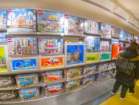 Bologna, Italy - December 6, 2018: opening shopping at famous Lego toys store of Bologna. Store full of exclusive Lego boxes.